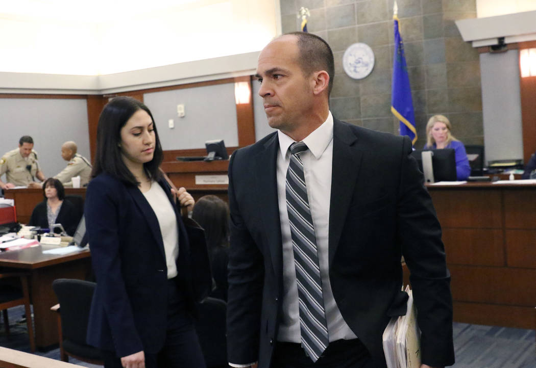 Chief Deputy District Attorney, Richard Scow, right, leaves the courtroom after a hearing at th ...