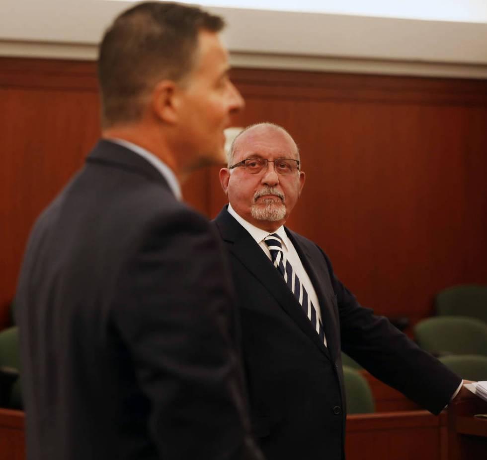 Attorney Christian Matthew, representing the Las Vegas Metropolitan Police Department, left, an ...