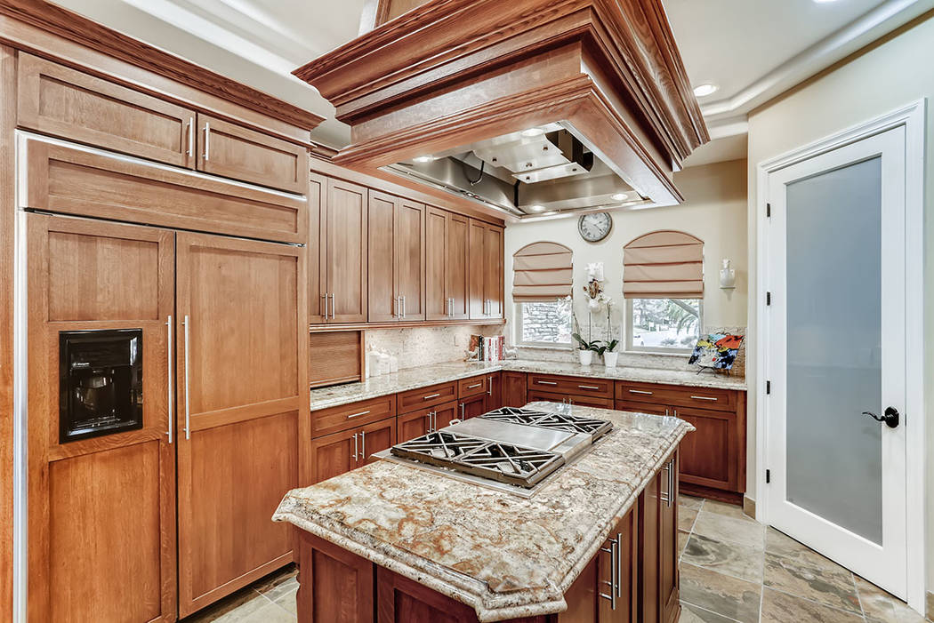 A large center island is showcased in the kitchen. (Berkshire Hathaway HomeServices)