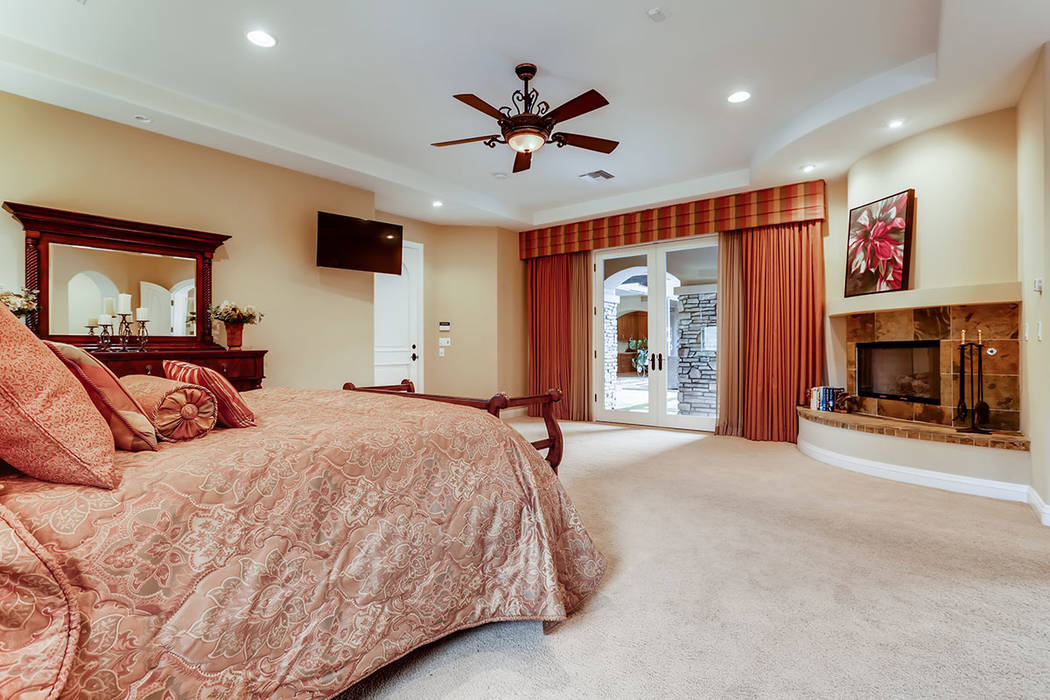 The master suites opens to a patio. (Berkshire Hathaway HomeServices)