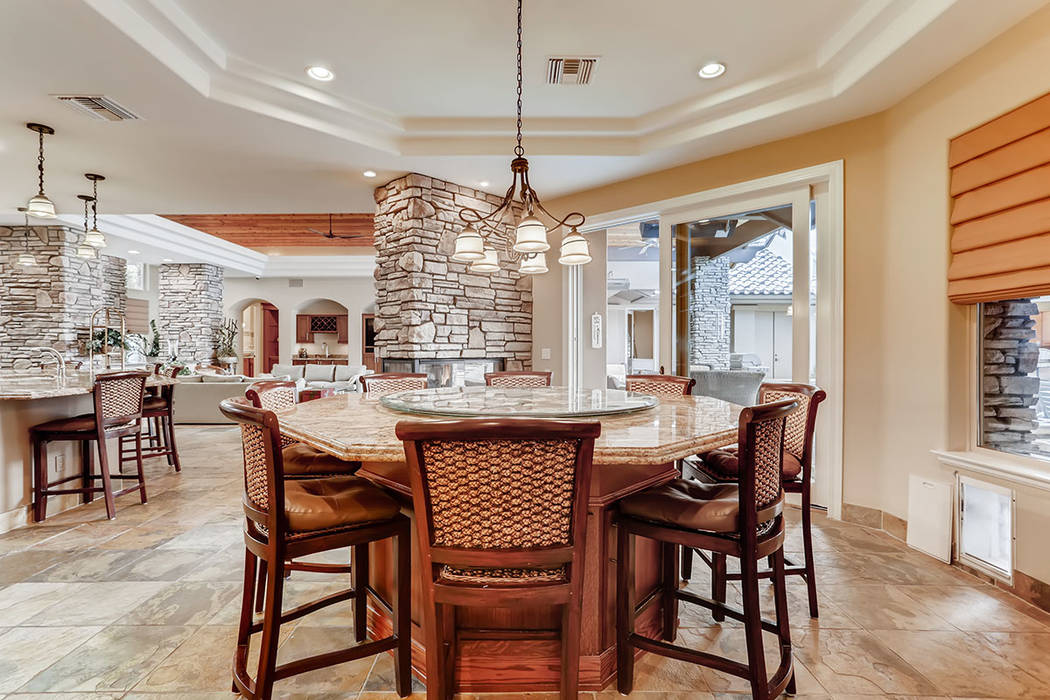 A central, built-in, 7-foot octagon-shaped dining table can seat up to 16 people. (Berkshire Ha ...