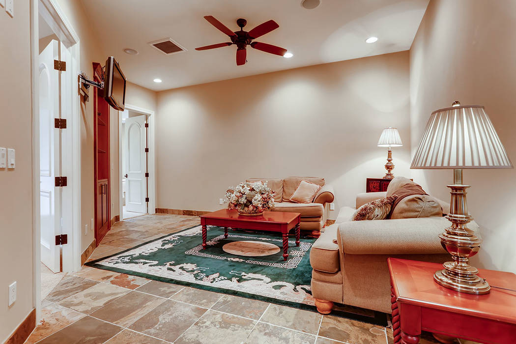 The guesthouse has a cozy family room. (Berkshire Hathaway HomeServices)