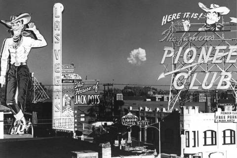 The mushroom cloud from a test of an atomic-bomb is seen from Fremont Street in downtown Las Ve ...