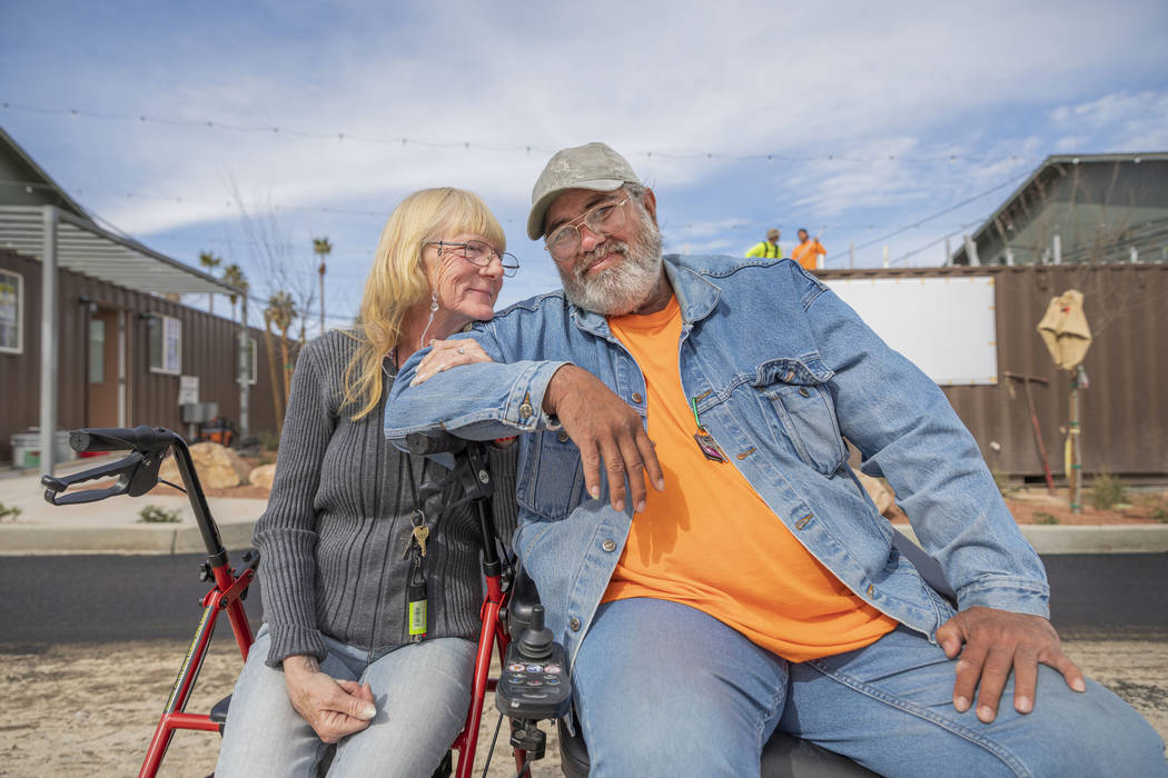 Donna Charles, 65, left, and Robert Caris, 63, an engaged couple that are photographed in front ...