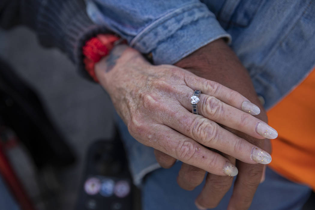 Donna Charles, 65, left, and Robert Caris, 63, hold hands in front of their new SHARE module co ...