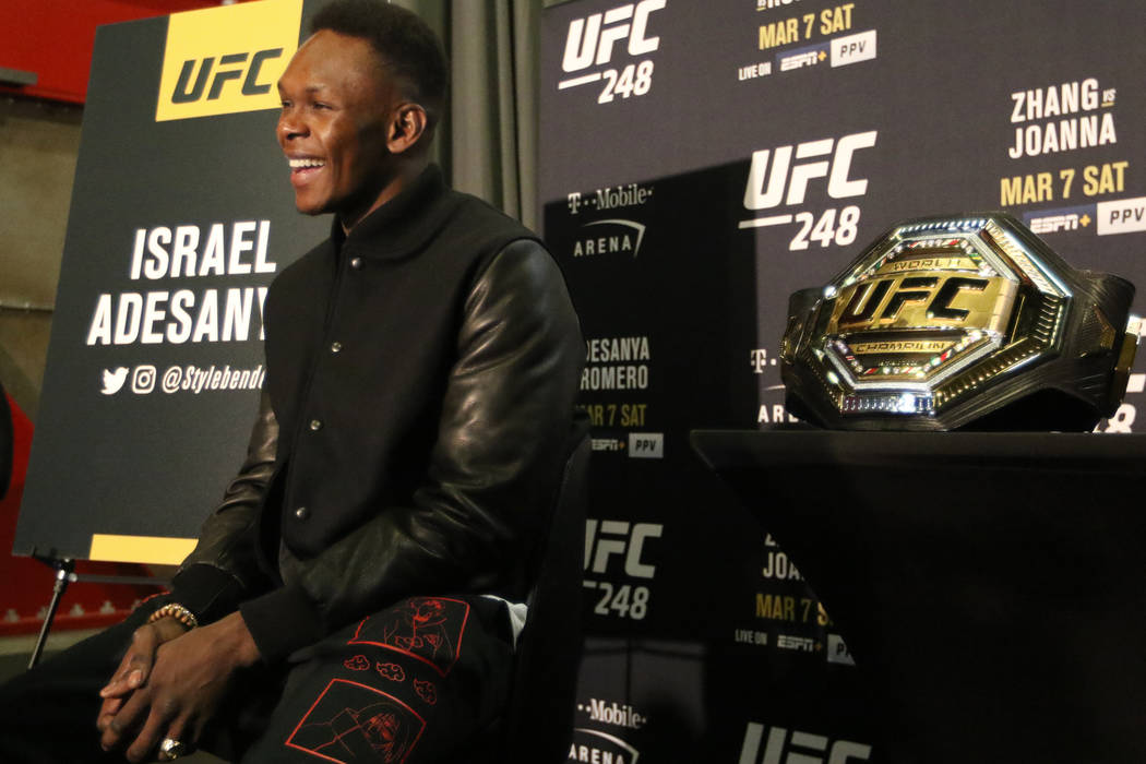 UFC middleweight champion Israel Adesanya is interviewed during UFC 248 media day at the UFC Ap ...