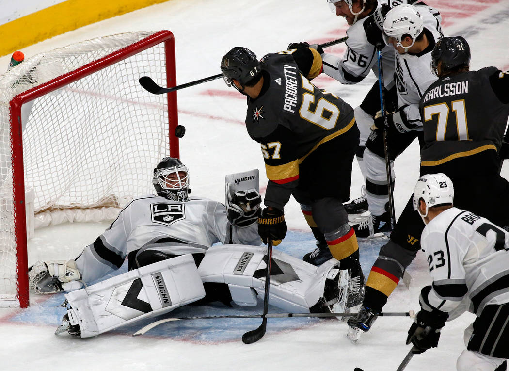Los Angeles Kings goaltender Calvin Petersen (40) makes a save on a shot by Vegas Golden Knight ...