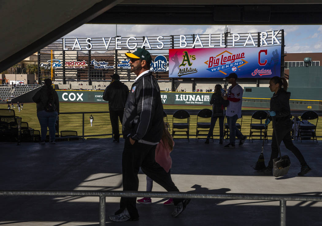 Fans walk in the stadium as the Cleveland Indians and Oakland Athletics play during a Big Leagu ...