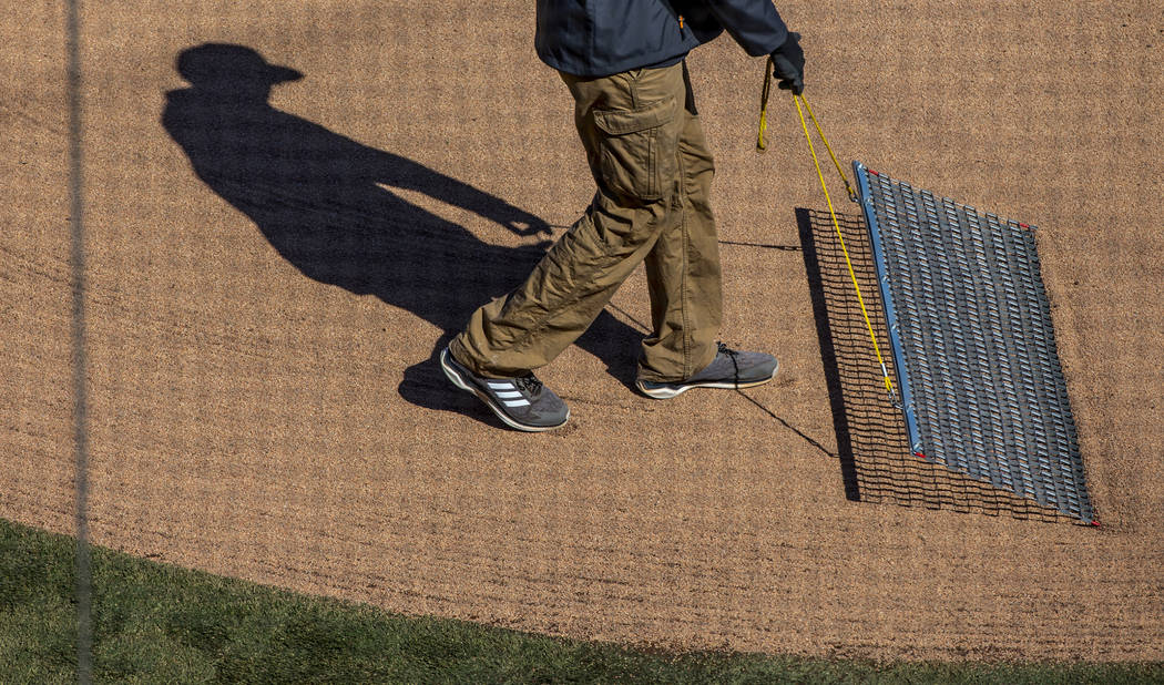 The home plate area is smoothed out as the Cleveland Indians and Oakland Athletics ready to pla ...