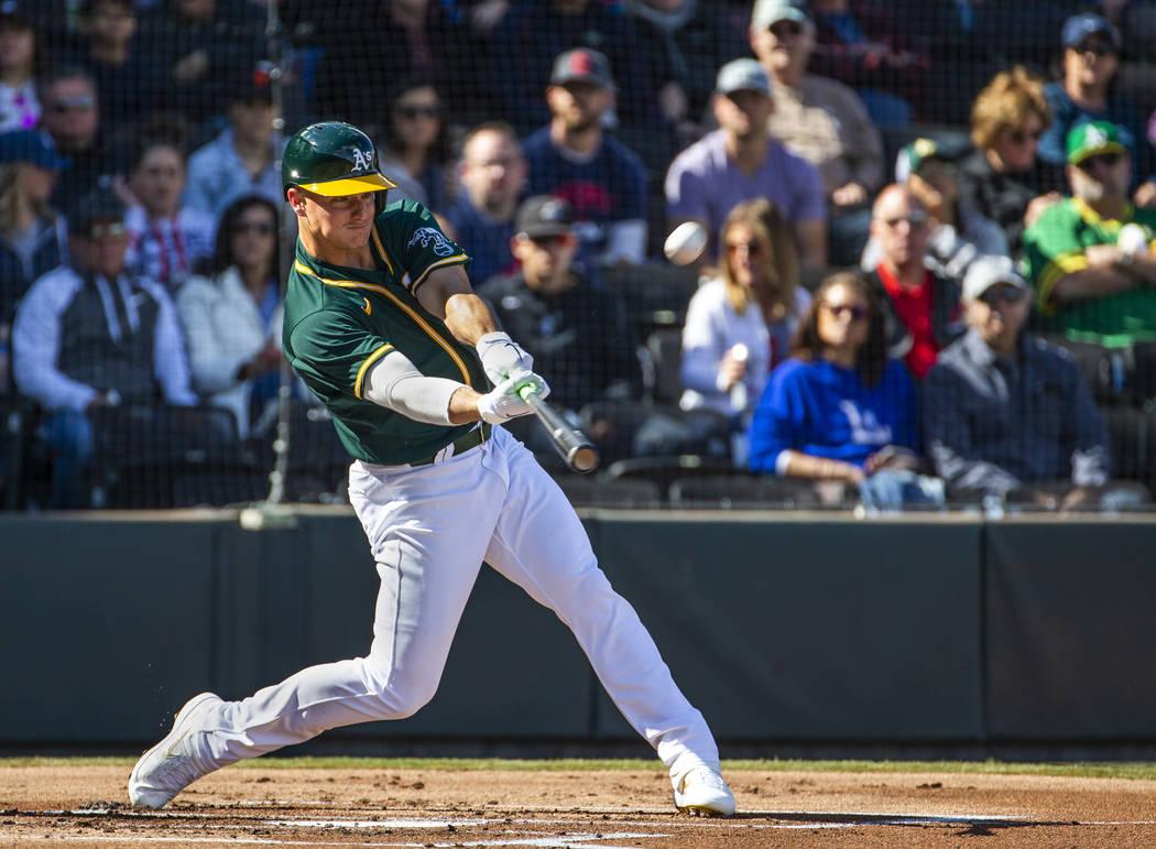 Oakland Athletics infielder Matt Chapman (26) drives a pitch towards the outfield versus the Cl ...