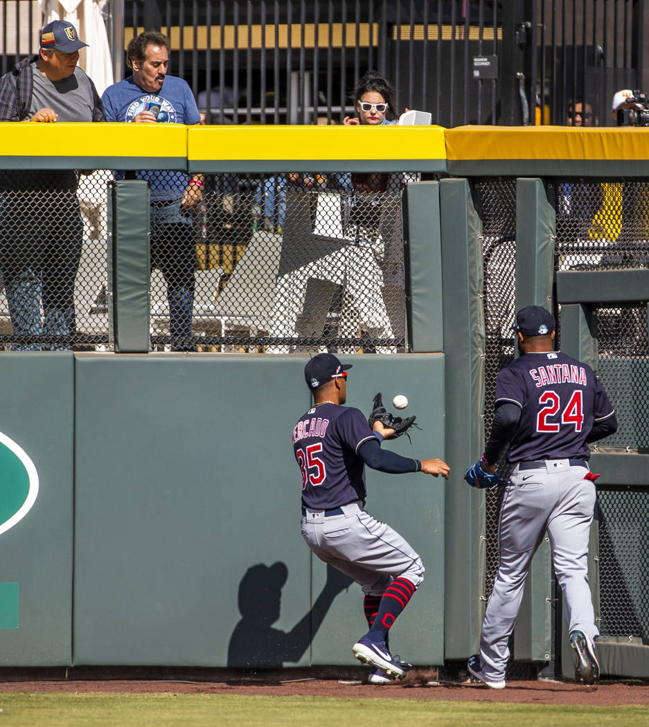 Cleveland Indians outfielder Oscar Mercado (35) attempts a catch off the wall beside teammate D ...