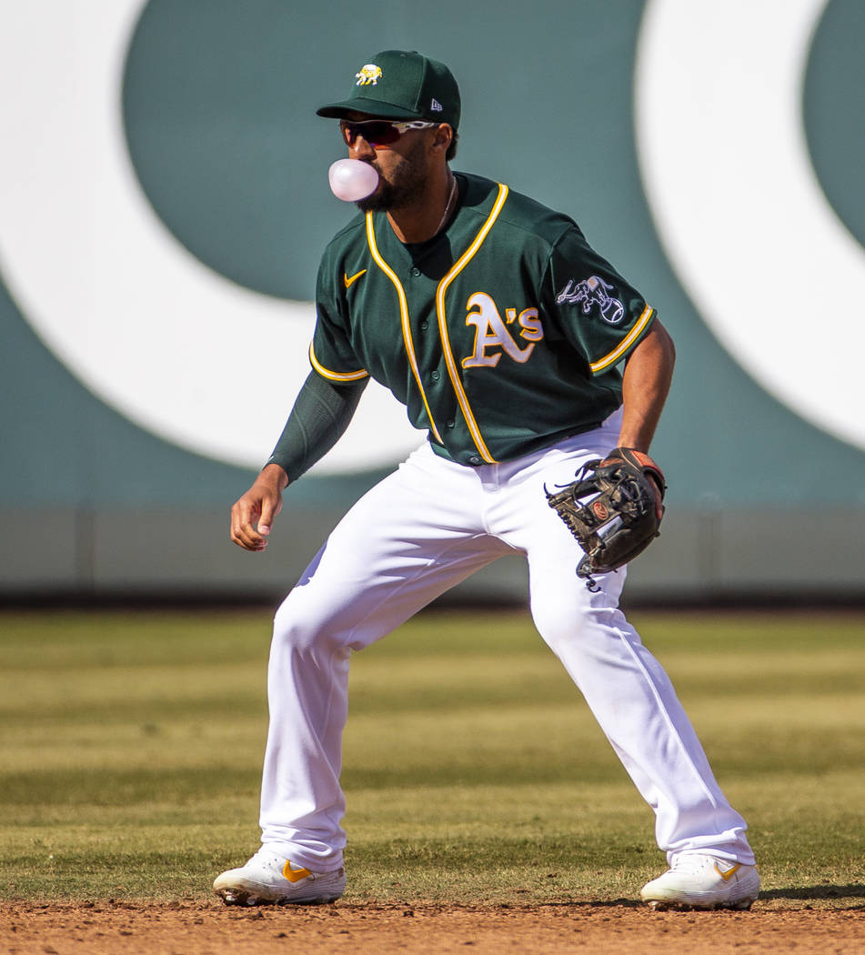 Oakland Athletics infielder Marcus Semien (10) blows a bubble while at shortstop versus the Cle ...