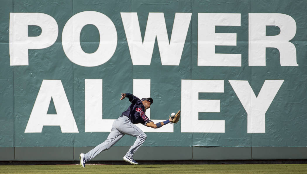 Cleveland Indians outfielder Greg Allen (1) bobbles a long fly ball hit by the Oakland Athletic ...