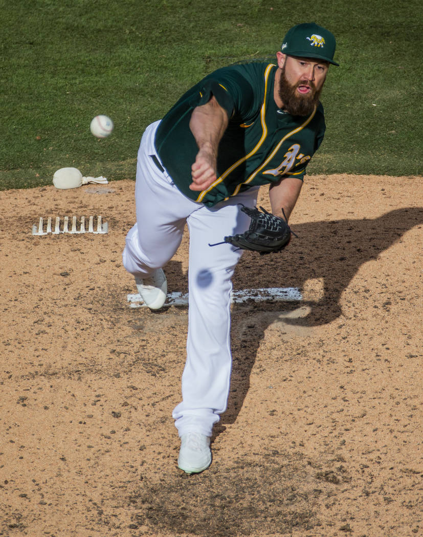 Oakland Athletics pitcherBrian Schlitter (54) releases another ball towards a Cleveland Indians ...