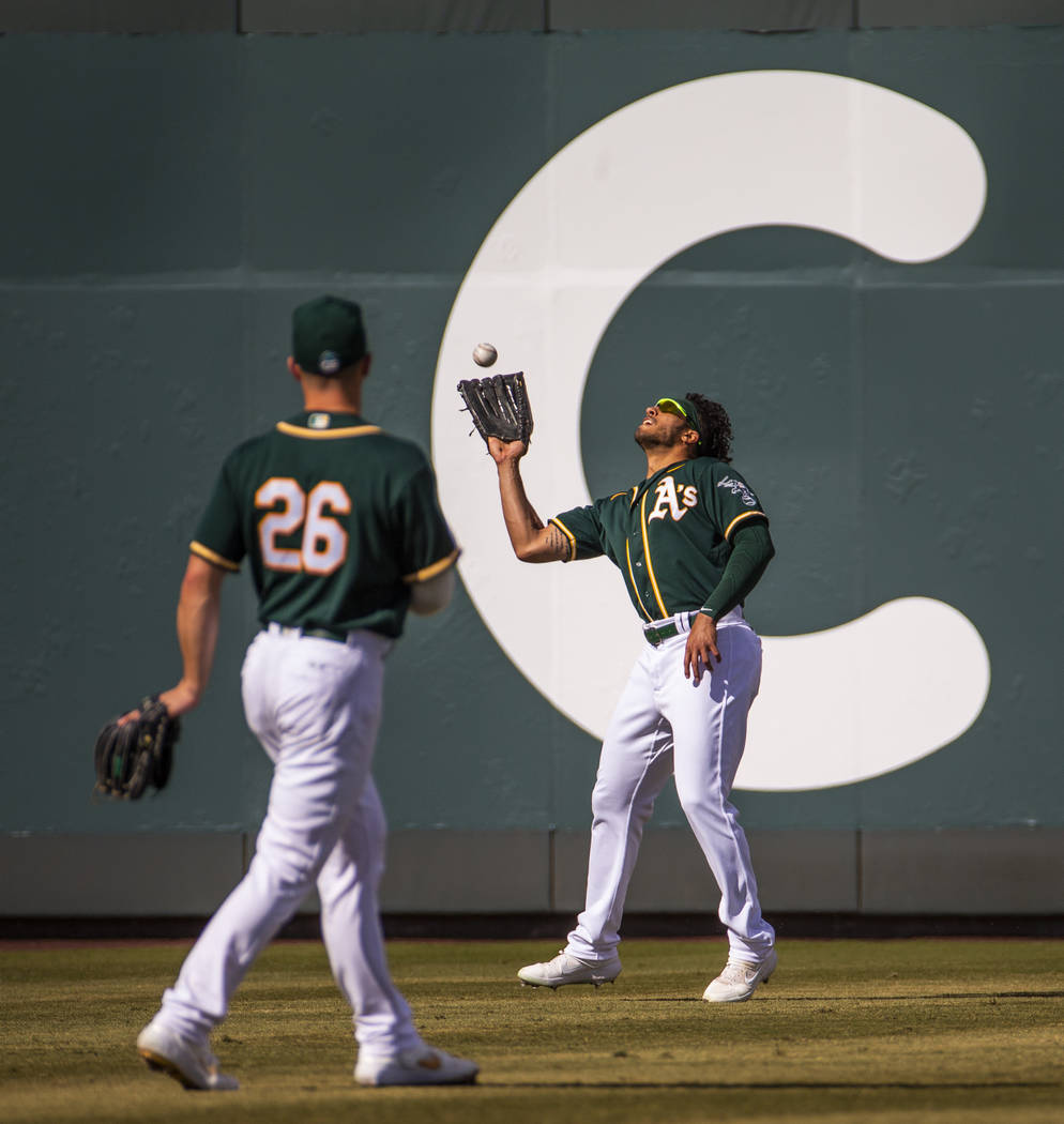 Oakland Athletics outfielder Dillon Thomas (71) looks in a long fly ball by the Cleveland India ...