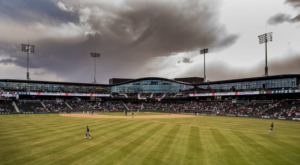 Storm clouds begin to roll in as the Cleveland Indians and Oakland Athletics meet during a Big ...