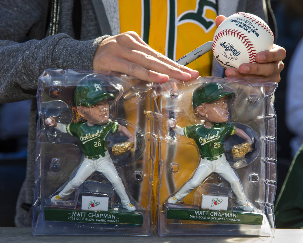A young fan waits for an autograph from an Oakland Athletics player during a Big League Weekend ...