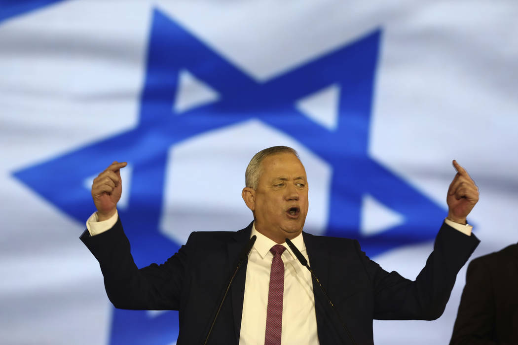 Blue and White party leader Benny Gantz addresses his supporters during election campaign rally ...