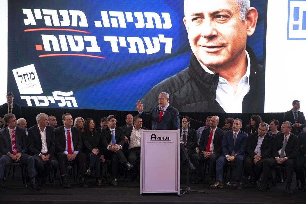 Israeli Prime Minister Benjamin Netanyahu, center, speaks during a Likud faction meeting in Tel ...