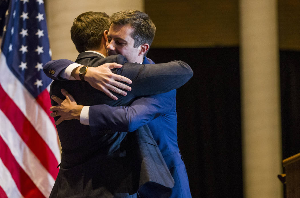 Pete Buttigieg, right, hugs his husband, Chasten Buttigieg, before ending his presidential camp ...