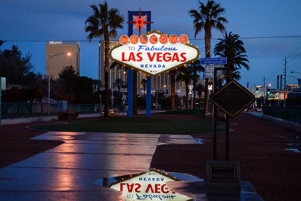 Rain puddles are seen at the Welcome to Fabulous Las Vegas sign in February 2019. (Las Vegas Re ...