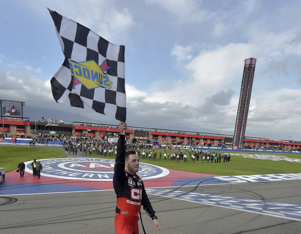 Alex Bowman celebrates with the checkered flag after winning a NASCAR Cup Series auto race Sund ...