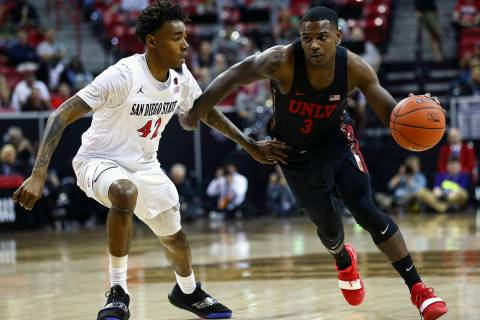 UNLV Rebels guard Amauri Hardy (3) brings the ball up court against San Diego State Aztecs guar ...