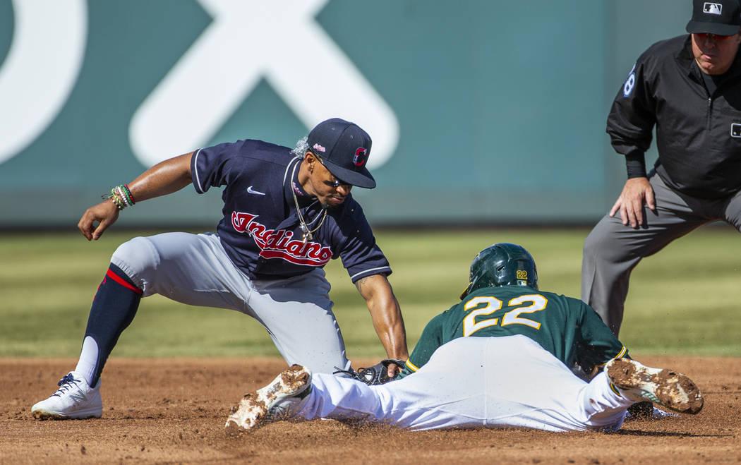 Cleveland Indians infielder Francisco Lindor (12) tags out Oakland Athletics runner Ramon Laur ...
