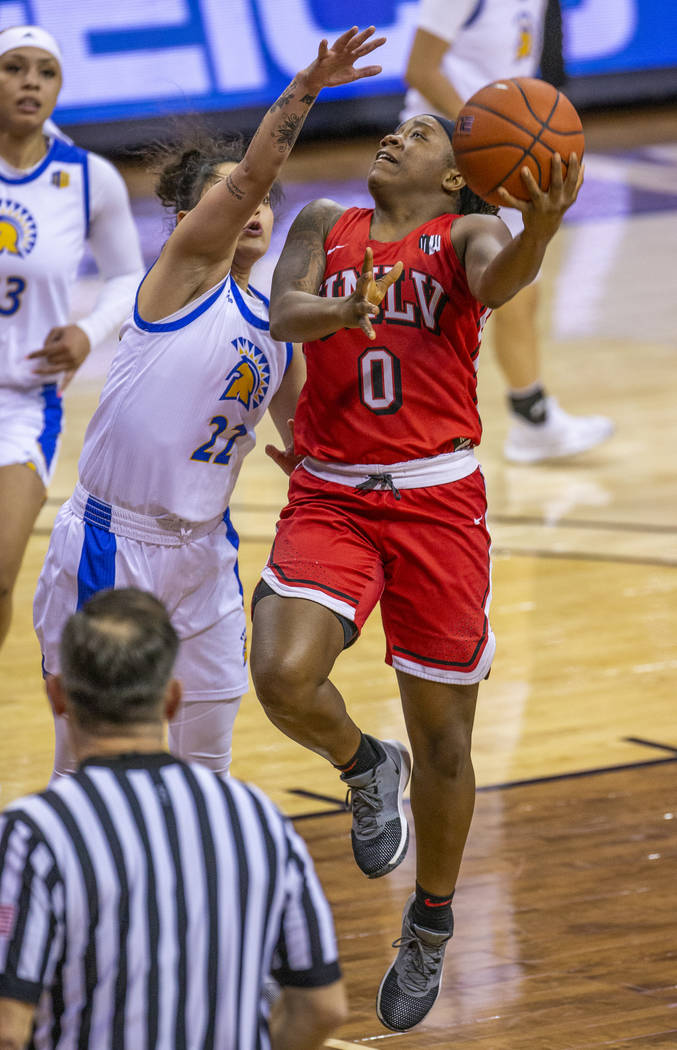 UNLV Lady Rebels guard LaTecia Smith (0, right) looks to lay in the ball over San JosŽ St ...