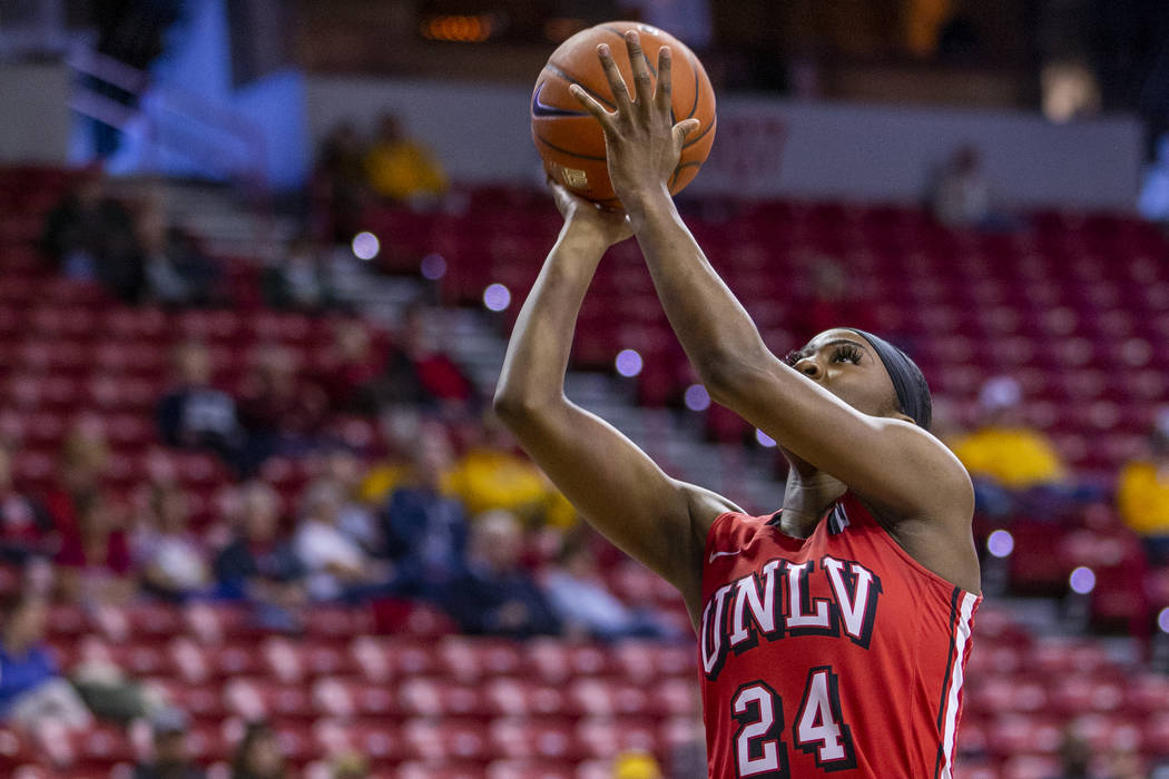 UNLV Lady Rebels guard Rodjanae Wade (24, center) catches some air as she sets up a shot past S ...