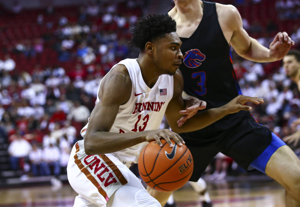 UNLV Rebels' Bryce Hamilton (13) drives to the basket against Boise State Broncos' Justinian Je ...