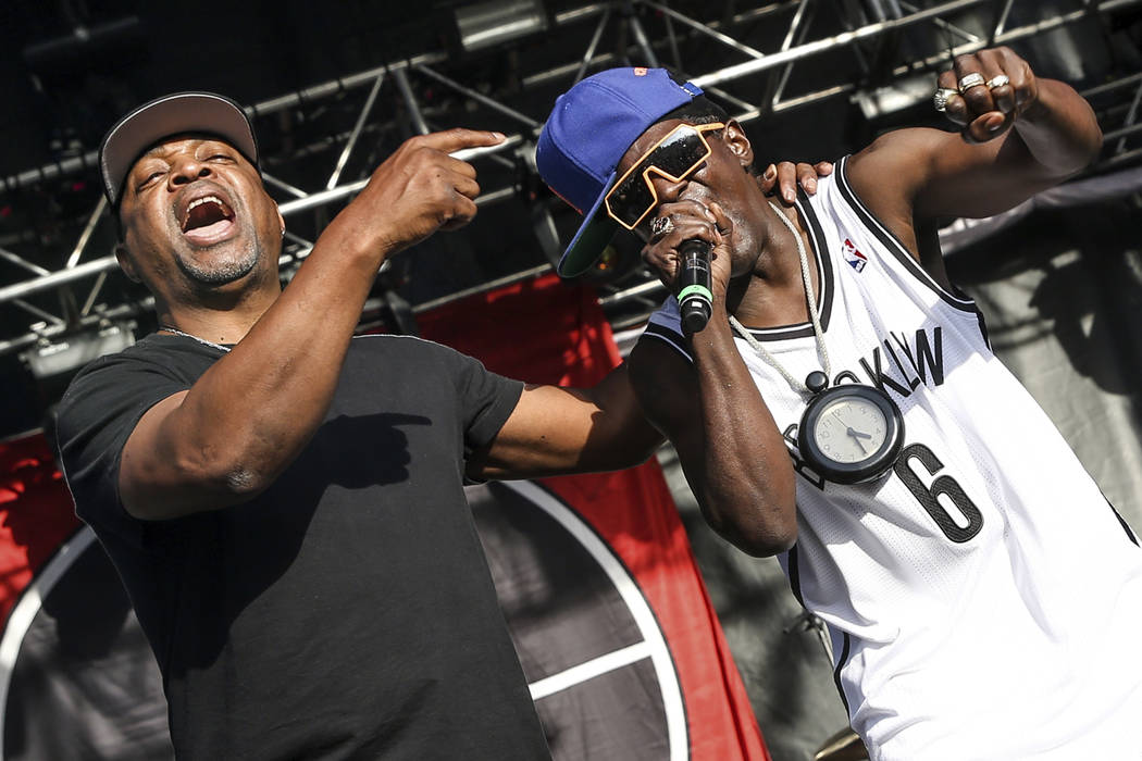 This May 29, 2015 file photo shows Chuck D, left, Flavor Flav of Public Enemy performing at the ...