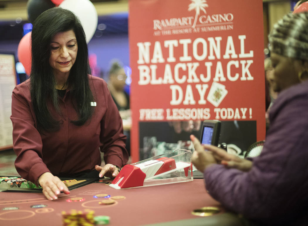 Izzy, a blackjack dealer, deals for Barbara Wright, right, of Las Vegas, at Rampart Casino in L ...