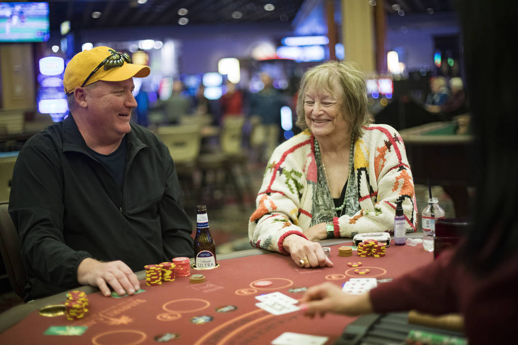 Jeff Siegrist, left, of Illinois, plays blackjack with Karen Allison, right, of Las Vegas, at R ...