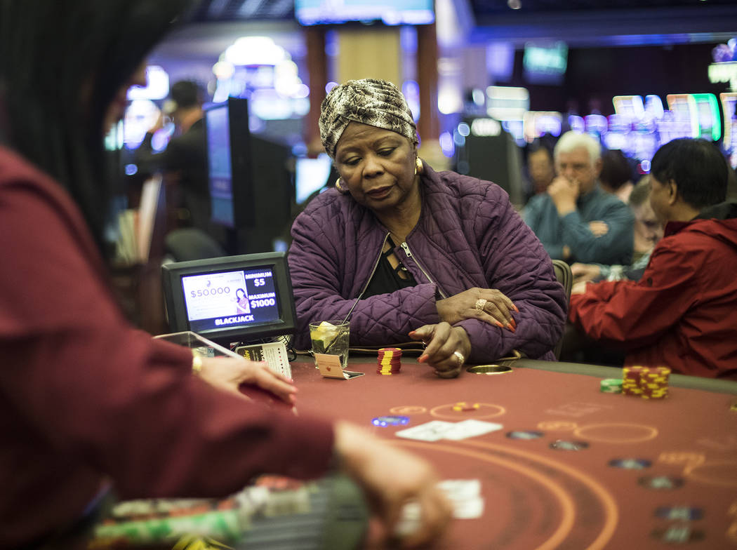 Barbara Wright, of Las Vegas, plays blackjack at Rampart Casino in Las Vegas, Sunday, March 1, ...