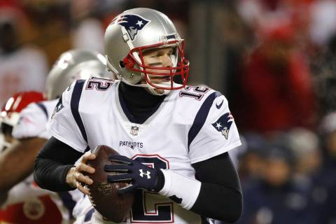 New England Patriots quarterback Tom Brady looks for a receiver during the first half of the AF ...