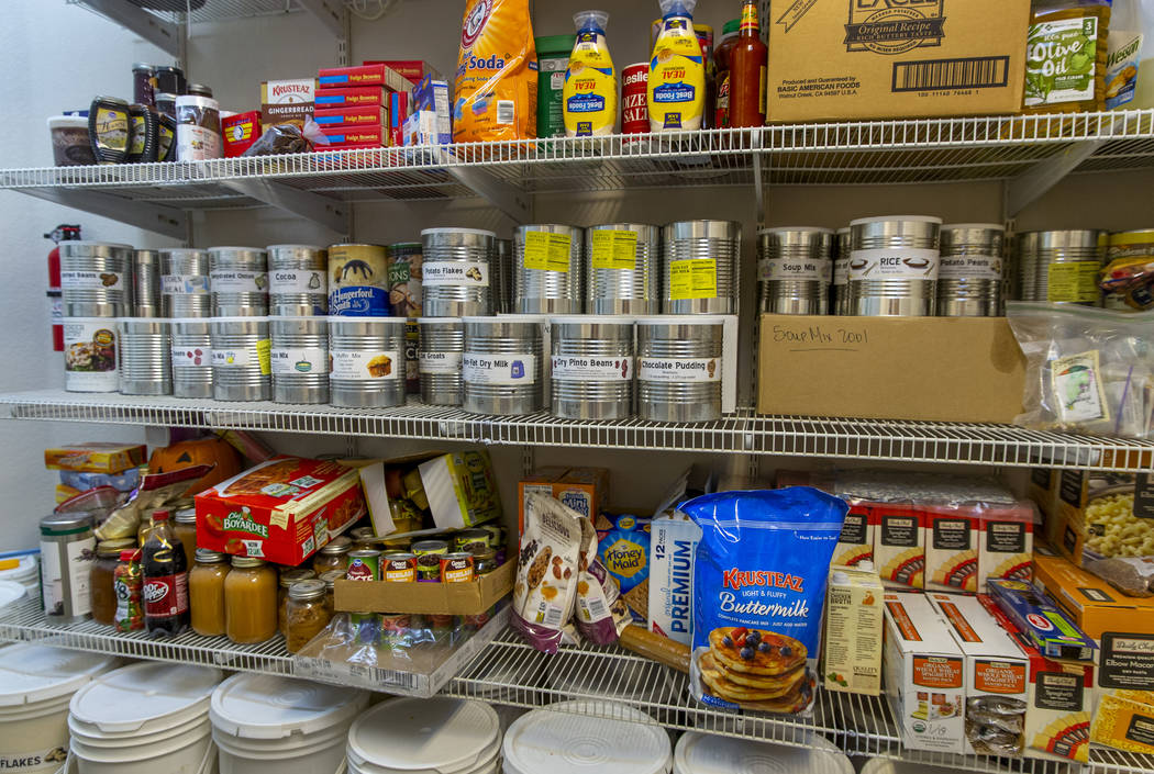 Some of the many food items stored in the home pantry of Cory and Holly Steed on Monday, March ...