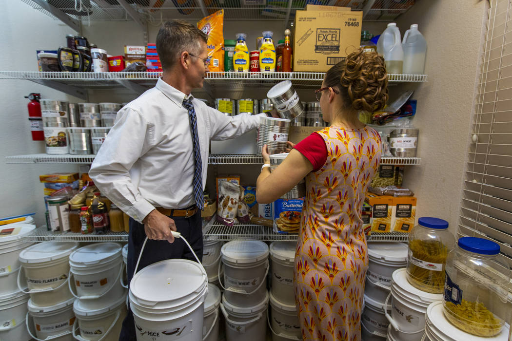 Cory, left, and Holly Steed sort through some of the food items stored in their home pantry on ...