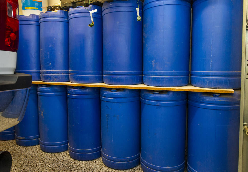 Barrels of water stored in the home garage of Cory and Holly Steed on Monday, March 2, 2020 in ...