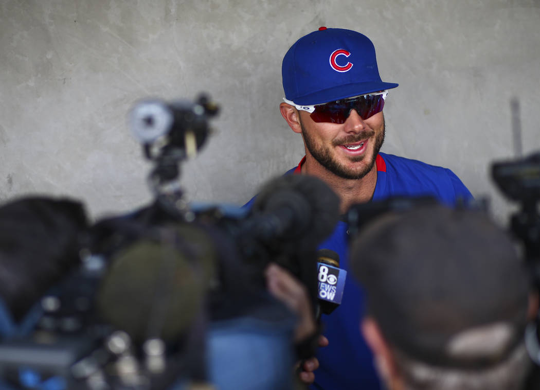 Chicago Cubs' Kris Bryant speaks with the media before a baseball game against the Cincinnati R ...