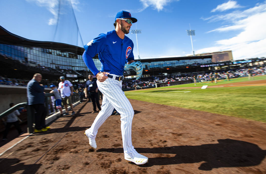 Chicago Cubs' Kris Bryant runs onto the field before the start of a baseball game against the C ...