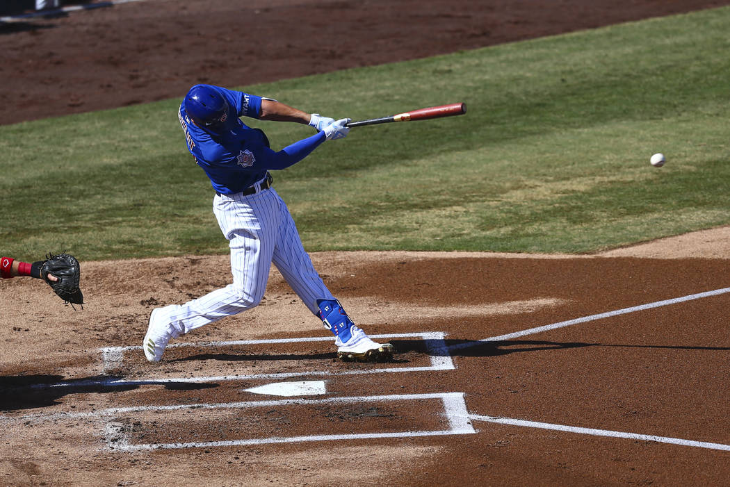 Chicago Cubs' Kris Bryant hits the ball during the first inning of a Big League Weekend basebal ...