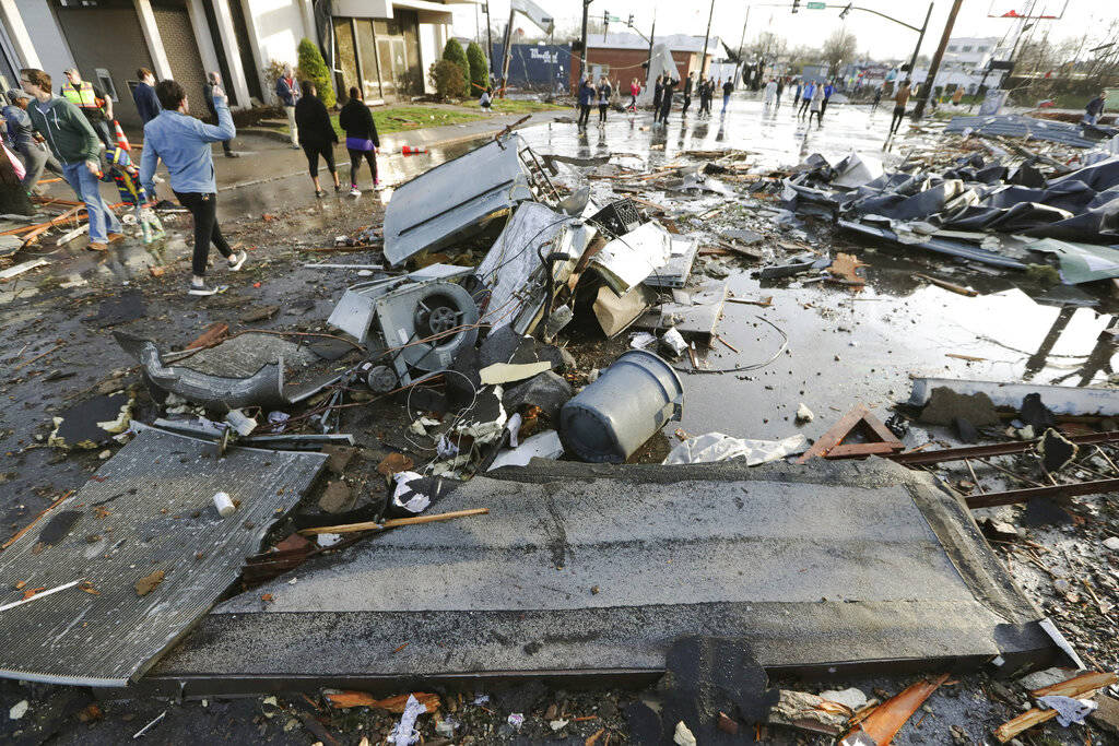 Debris covers a street after overnight storms Tuesday, March 3, 2020, in Nashville, Tenn. Torna ...