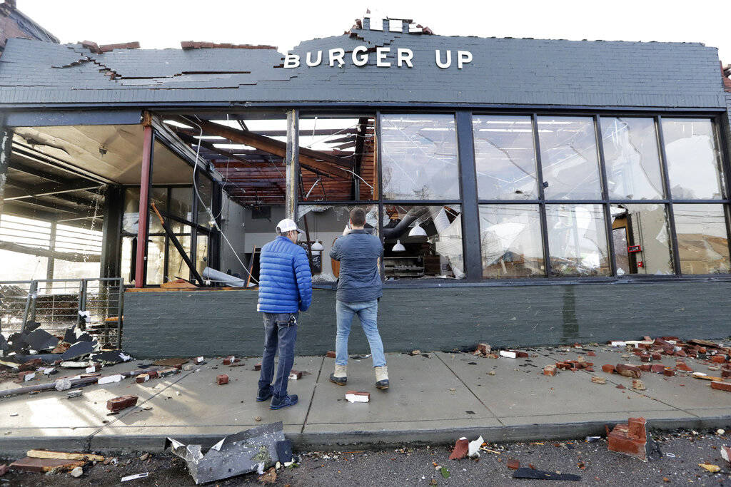 People look over a restaurant destroyed by storms Tuesday, March 3, 2020, in Nashville, Tenn. T ...