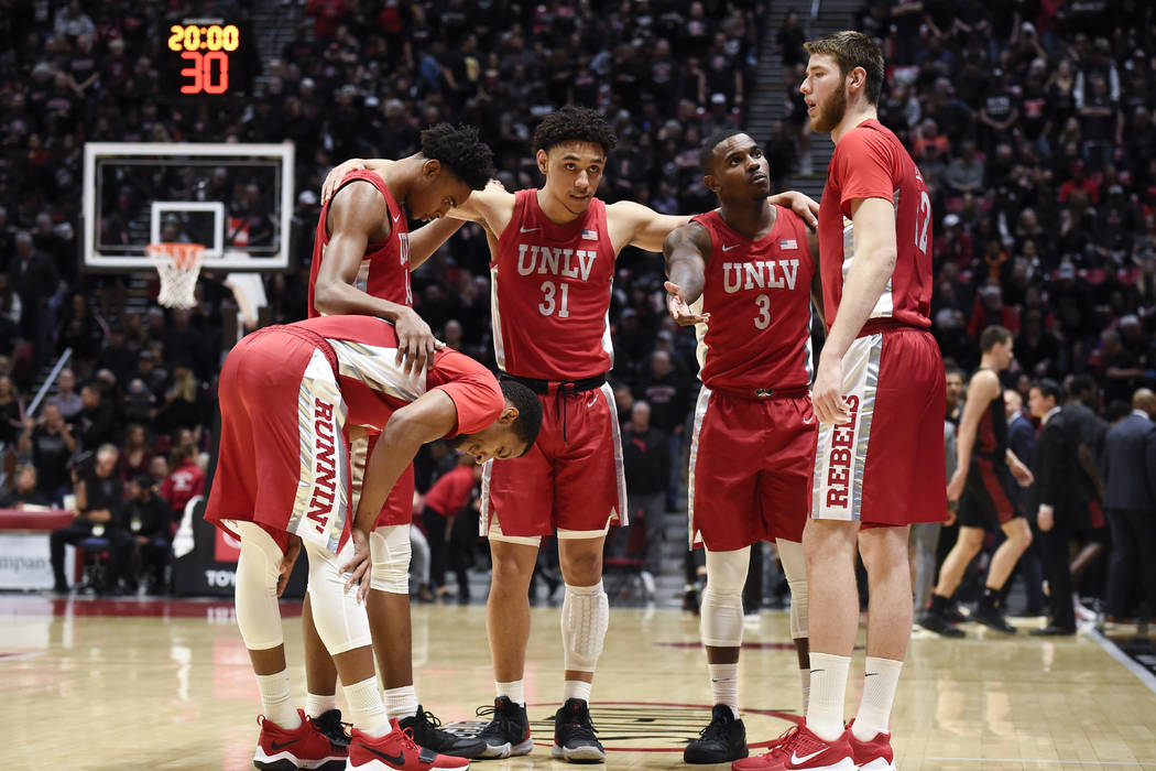 UNLV players huddle before an NCAA college basketball game against San Diego State Saturday, Fe ...