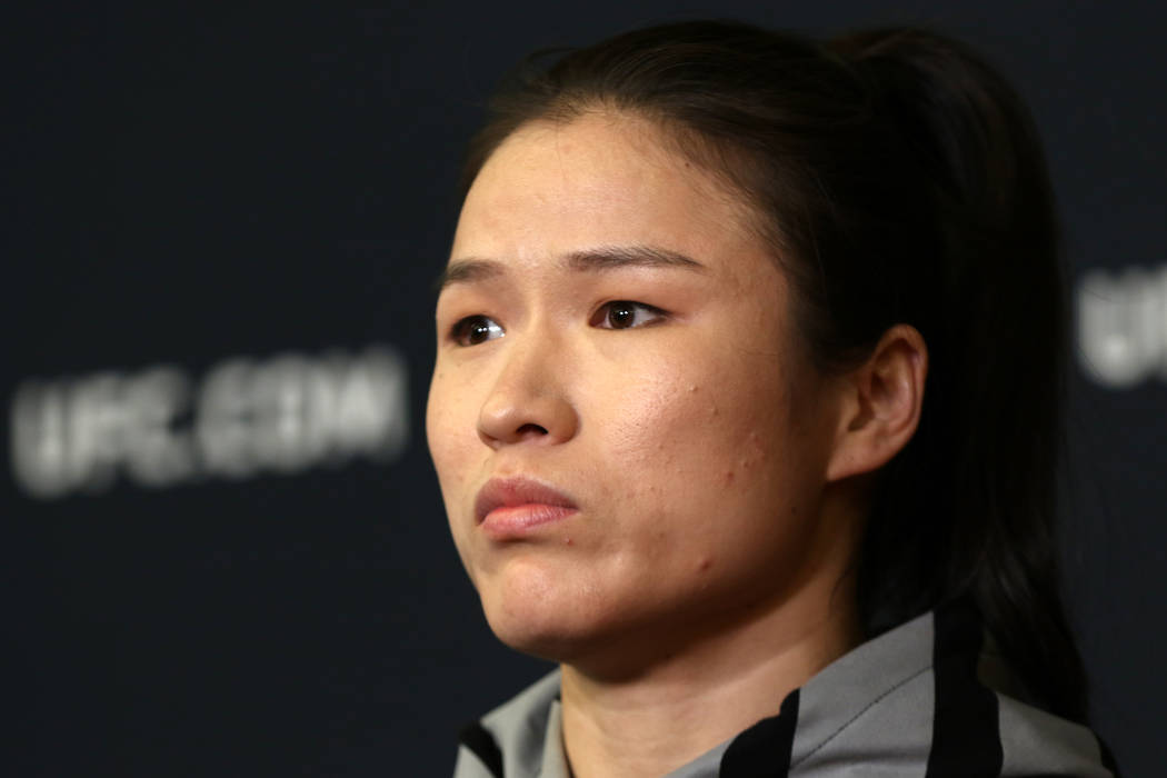UFC strawweight champion Zhang Weili listens to questions during a news conference at the UFC A ...
