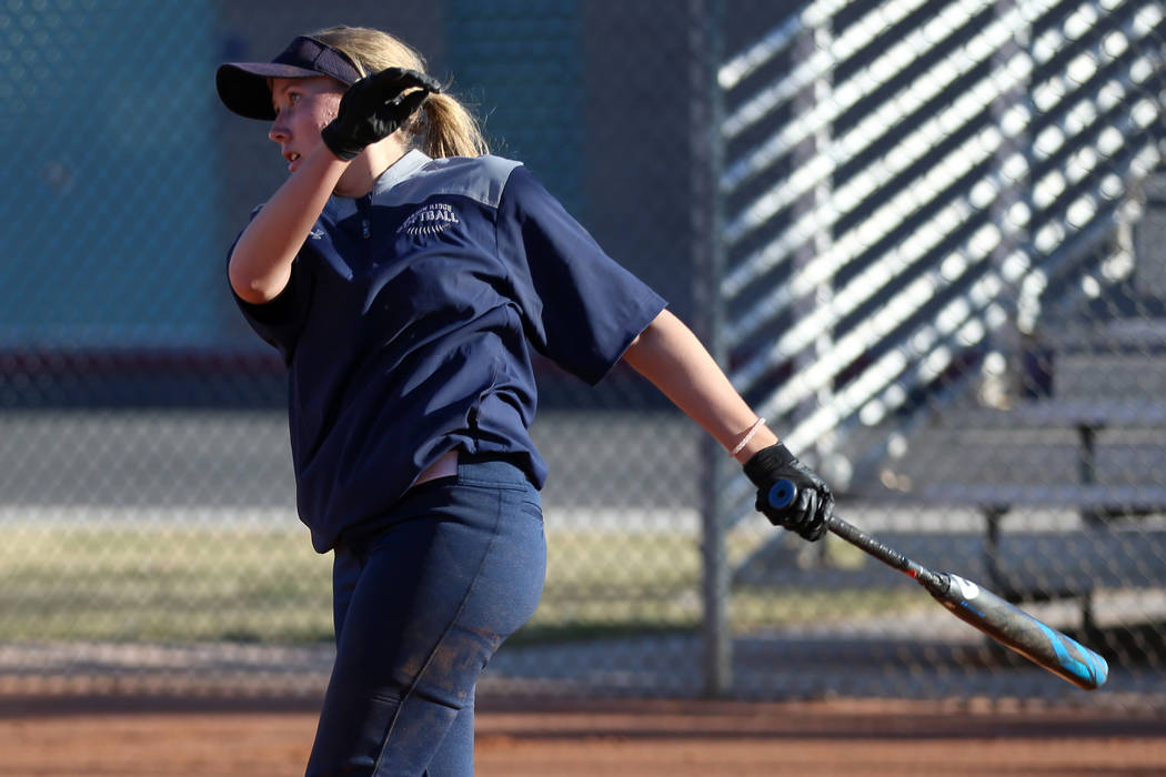 Shadow Ridge's Hailey Morrow, 16, connects with the ball during a softball practice at Shadow R ...