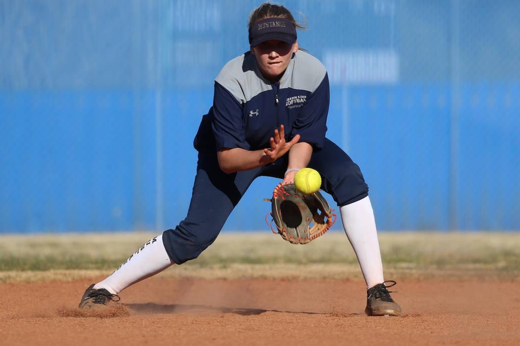 Shadow Ridge's Hailey Morrow, 16, reaches for a ground ball during a softball practice at Shado ...