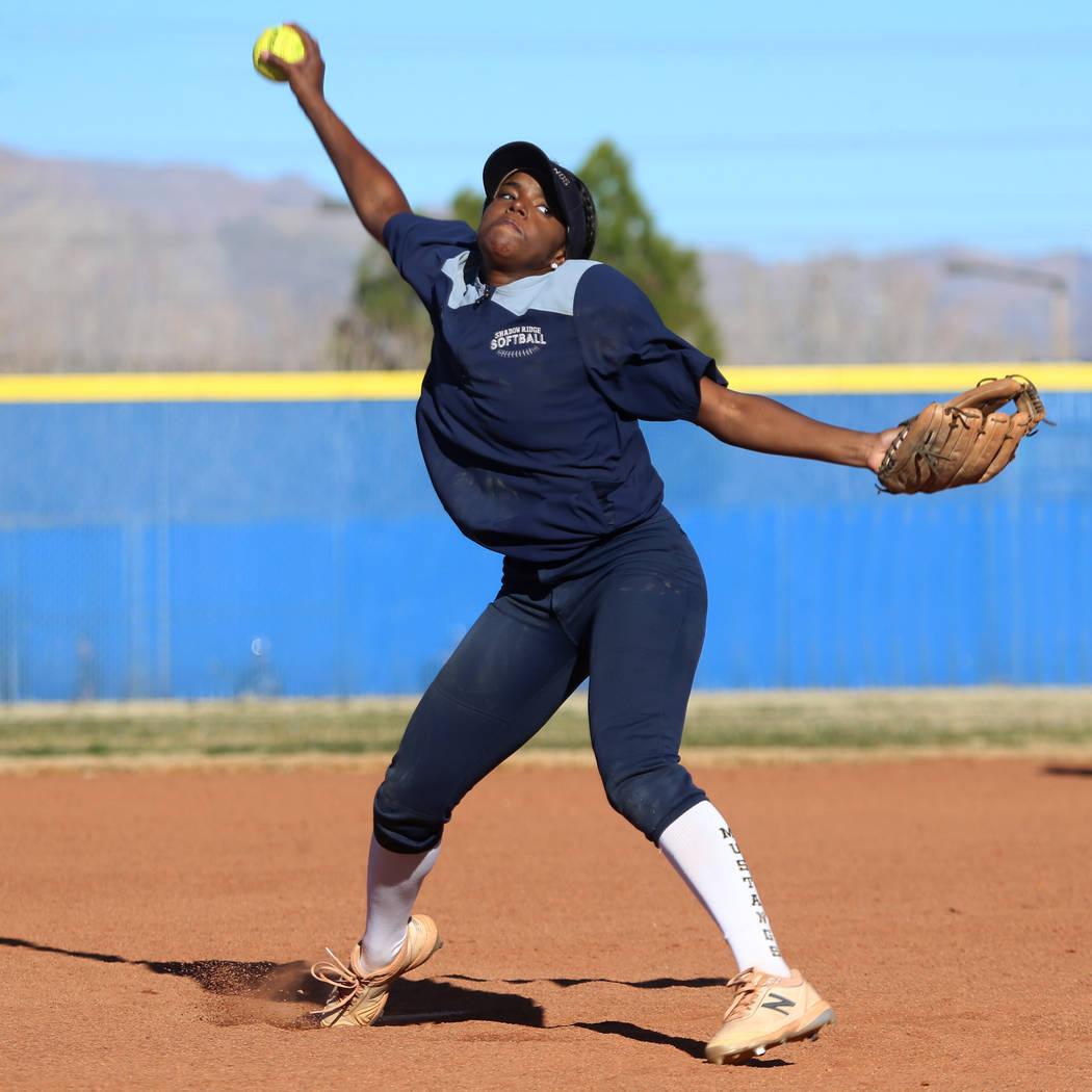 Shadow Ridge's Jasmine Martin, 17, pitches the ball during a softball practice at Shadow Ridge ...