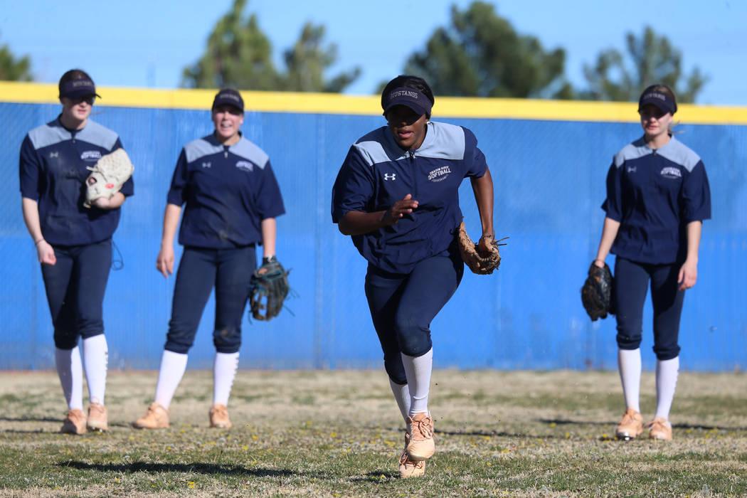 Shadow Ridge's Jasmine Martin, 17, sprints during a softball practice at Shadow Ridge High Scho ...